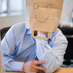 Anonymous corporate guy with a bag over his head.